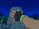 EP525 Ash coloca la última piedra del monumento.png