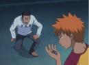 Isshin gives Ichigo a protective charm.png