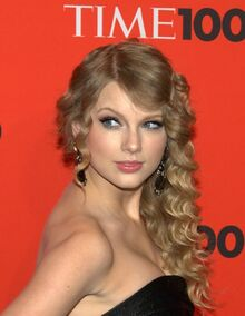 Taylor Swift is looking away from the camera.