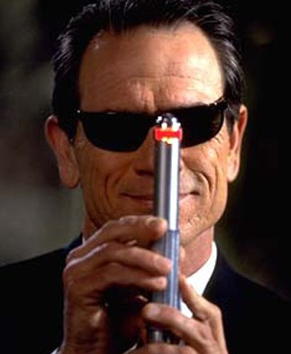 In Men in Black 3, the variant of a Neuralyzer is shown to be roughly the size of an MRI machine. Similar in shape to the miniature Neuralyzer, the version is a cylindrical tube positioned in the centre of a room and maintained by three MIB officials.
