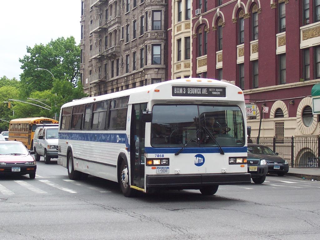 1992 gillig bus going through city in evansvilleindiana - 1 10