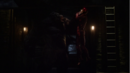 Grodd lifts Barry by the throat.png