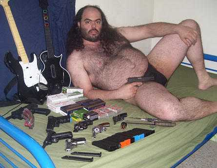 [Image: Weird-guy-with-guns.jpg]