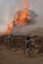 GIs burn a suspected Taliban safehouse.jpg