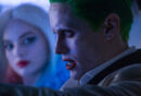 Harley Quinn watches as the Joker drives.jpg